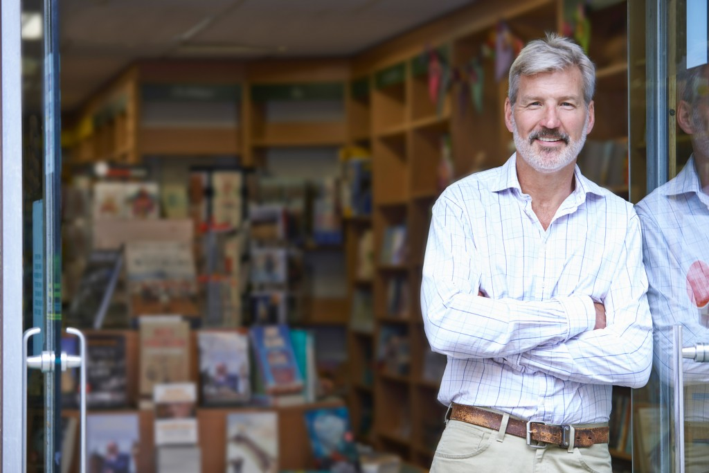 Bookshop Owner Outside Store