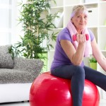 Senior woman exercising at home and smiling